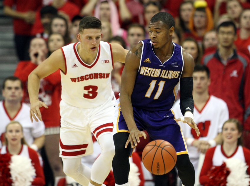 Nov 13, 2015; Madison, WI, USA; Western Illinois Leathernecks guard Delo Bruster looks to pass as Wisconsin Badgers guard Zak Showalter (3) defends at the Kohl Center. Western Illinois defeated Wisconsin 69-67. Mandatory Credit: Mary Langenfeld-USA TODAY Sports