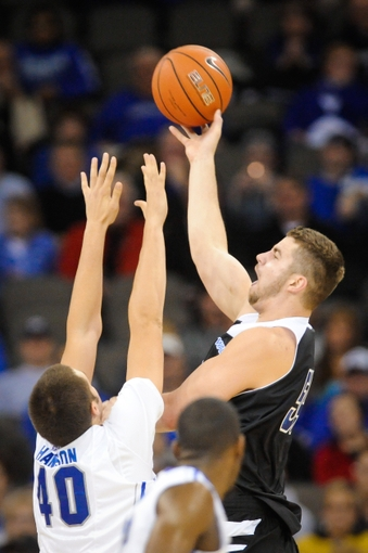 Nov 11, 2013; Omaha, NE, USA; UMKC Kangaroos forward/center Isaac Kreuer (54) takes a shot over Creighton Bluejays forward Zach Hanson (40) during their NCAA basketball game at the CenturyLink Center. Mandatory Credit: Dave Weaver-USA TODAY Sports