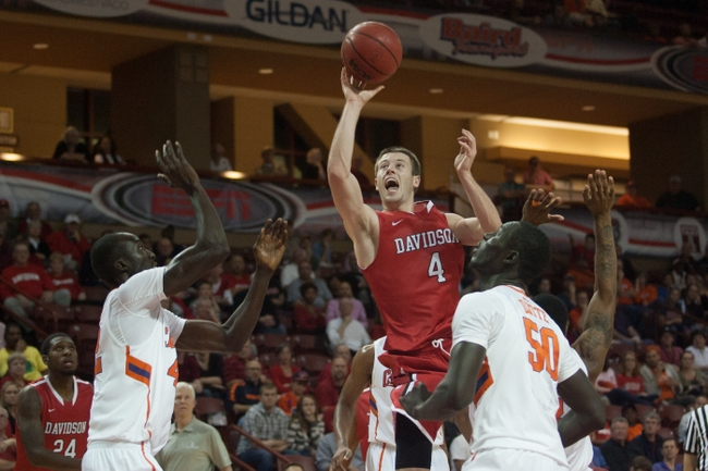 Nov 22, 2013; Charleston, SC, USA; Davidson Wildcats guard Tyler Kalinoski (4) shoots the ball during the second half against the Clemson Tigers at TD Arena. Mandatory Credit: Jeremy Brevard-USA TODAY Sports